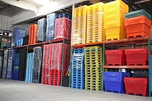 Warehouse with plastic pallets and bins in stock